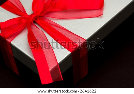 Black and silver gift box with red ribbon