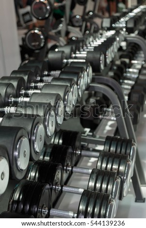 Black and Steel Dumbbells in Gym: Weight Fitness Equipment