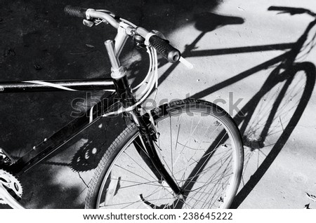 Black and white a bicycle against shadow / Black and white a bicycle   - stock photo