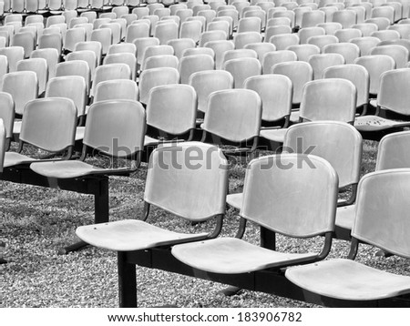 Black and white, abstract composition, background and texture from backrest of the seats and seats outdoors - stock photo