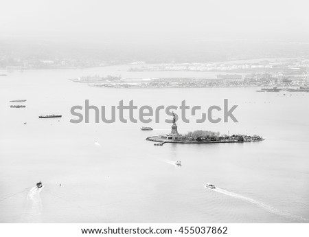 Black and white aerial view of statue of Liberty island in New York from one world trade center observatory - stock photo