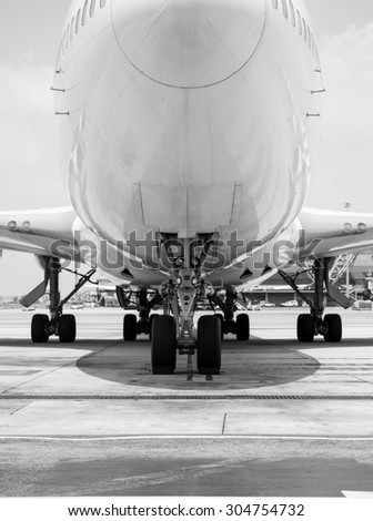black and white Airplane parked at the airport - stock photo