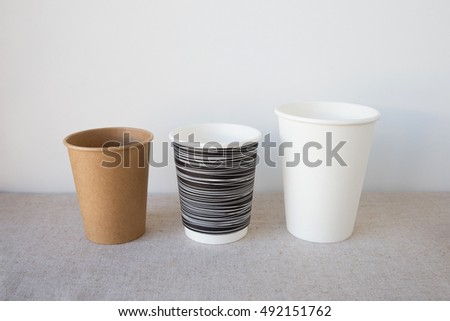 black and white and brown coffee paper cups