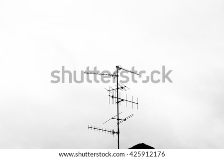 Black and white antenna mast on a roof - stock photo