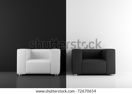 black and white armchairs in front of wall - stock photo
