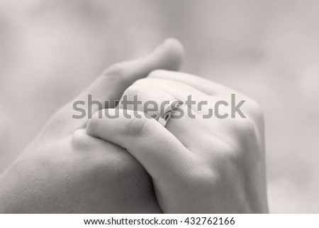 black and white art wedding photography monochrome bride and groom with wedding rings on their hands, young couple holding hands, male and female hand with wedding rings, wedding ceremony