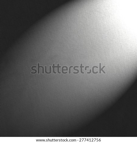 black and white background canvas paper and beam of spot light - stock photo