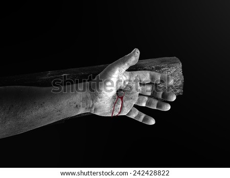 Black and white bleeding hand with nail on the cross. Christmas background, Forgiveness Mercy Repentance Reconcile Adoration Redeemer Redemption Gospel Love Faith Hope Eucharist Crucify Blood concept. - stock photo