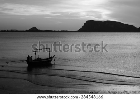 black and white boat on the beach - stock photo