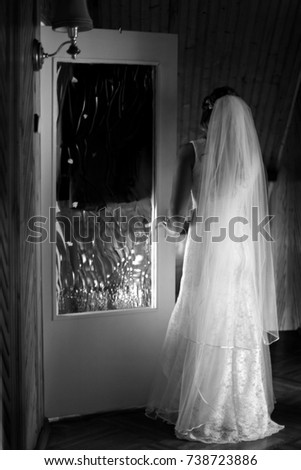 Black and white bride waiting near the doors