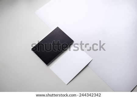 Black and white business cards for presentation of corporate identity. Top view. - stock photo