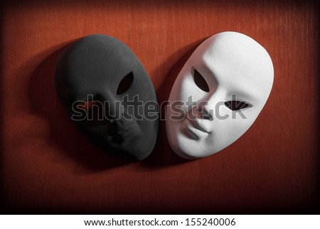Black and white carnival mask on a wooden background. - stock photo