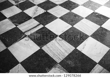 Black and white checkered marble floor pattern - stock photo
