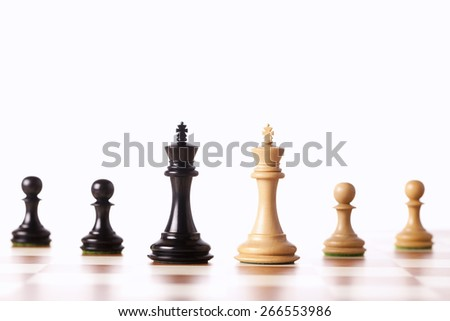black and white chess pieces  standing on a chessboard   - stock photo