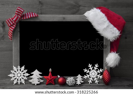 Black And White Christmas Chalkboard With Copy Space, Free Text. Red Christmas Decoration, Loop, Santa Hat, Christmas Ball, Christmas Tree, Snowflake. Wooden Background. Vintage Rustic Style. - stock photo