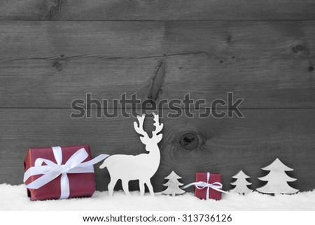 Black And White Christmas Decoration With Red Gifts Or Presents Moose Or Reindeer And Christmas Trees On Snow. Christmas Card For Seasons Greetings. Copy Space For Advertisement. Wooden Background - stock photo