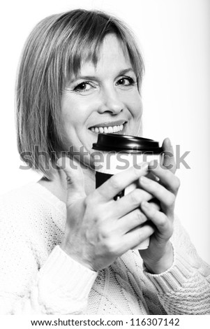 Black and white close up of midlle aged woman with coffee on a white background - stock photo
