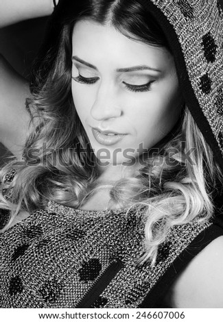 black and white close up portrait of a beautiful caucasian girl with perfect evening make up and long lashes looking down - stock photo