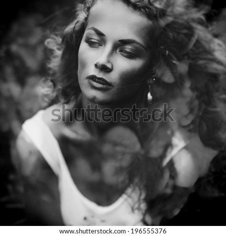 Black and white close-up portrait of beautiful fashionable girl with double exposure - stock photo