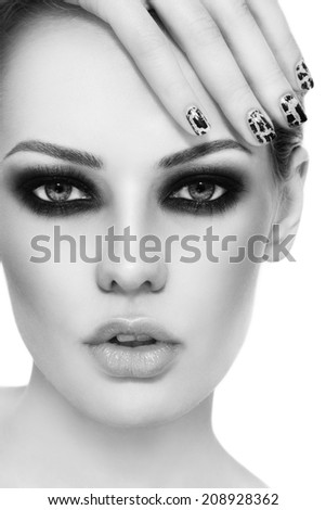 Black and white close-up portrait of young beautiful woman with stylish make-up and crackle manicure - stock photo