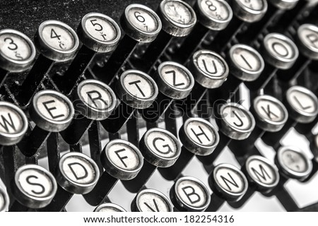 Black and white close-up view of an old typewriter keys - stock photo