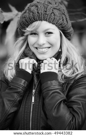 Black And White Close Up Winter Portrait Of Young Blonde Woman - stock photo
