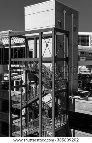 black and white closeup of a downtown building exterior stairway and part of the parking garage