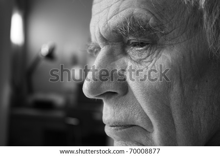 Black and white closeup of senior man - stock photo