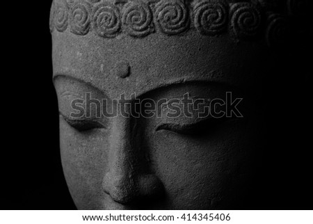 Black and white closeup picture of Buddha statue