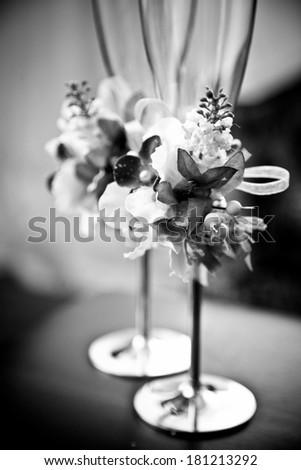 Black and white closeup shot of decorated wedding glasses - stock photo