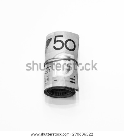 Black and white color of fifty dollars Australian notes roll on white background - stock photo