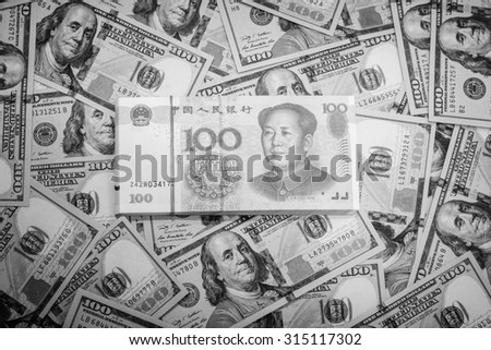 Black and white color of hundred banknote,Chinese currency yuan and American dollars,Focus on Chinese banknote - stock photo