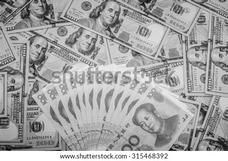 Black and white color of hundred banknote,Chinese currency yuan and American dollars,Focus on Chinese banknote