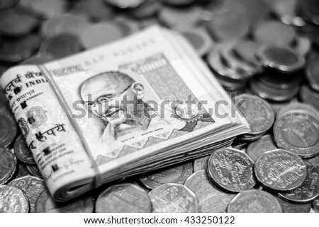 Black and white color of Indian Rupee currency,money banknotes and coins,Focus on eye of Gandhi