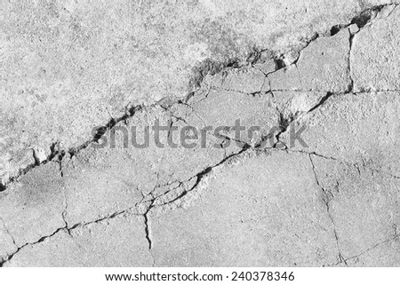 black and white cracked floor texture background - stock photo