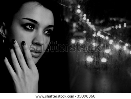 Black and white crying woman looking on a street - stock photo