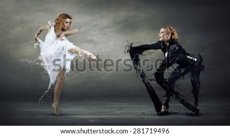 Black and white dancers - stock photo