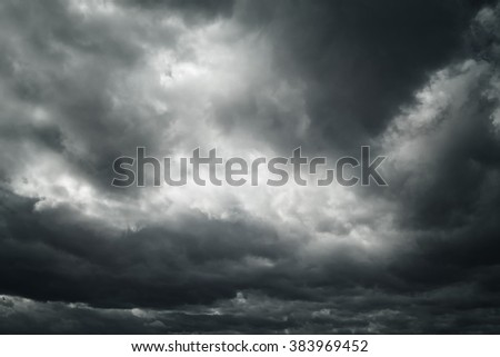 Black and white dangerous stormy dramatic cloudscape sky background. - stock photo