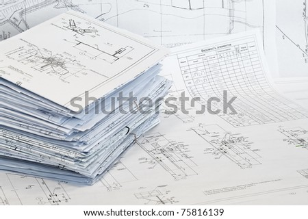Black and white dimensional drawings are compressed in single-sheet stationery. - stock photo