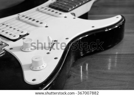 Black and white dirty electric guitar crop and selective focus.