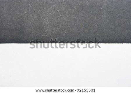 Black and white divided paper - stock photo