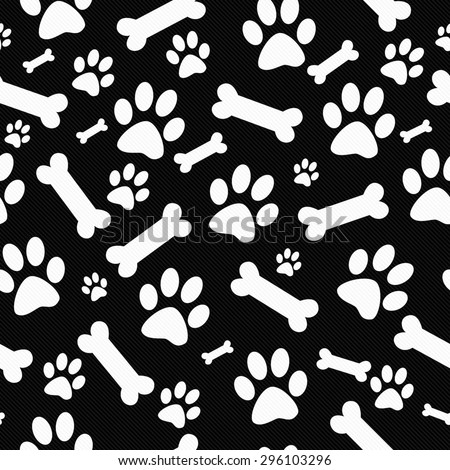 Black and White Dog Paw Prints and Bones Tile Pattern Repeat Background that is seamless and repeats - stock photo
