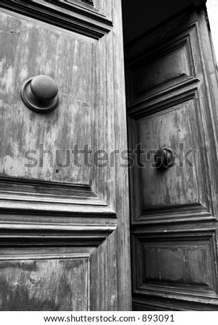 Black and white door in Italy. - stock photo
