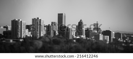 Black and white downtown Portland cityscape from unique perspective taken with tilt shift lens during sunny day - stock photo