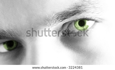 Black and white facial shot, with green tinted eyes. Short DOF. High key - stock photo