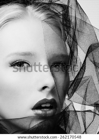 Black and white fashion photography of a beautiful young woman with veil
