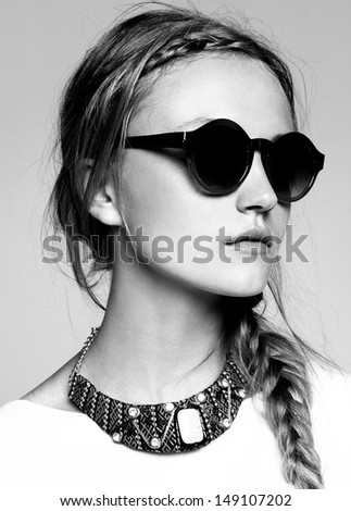 black and white fashion portrait of beautiful model with sunglasses  - stock photo