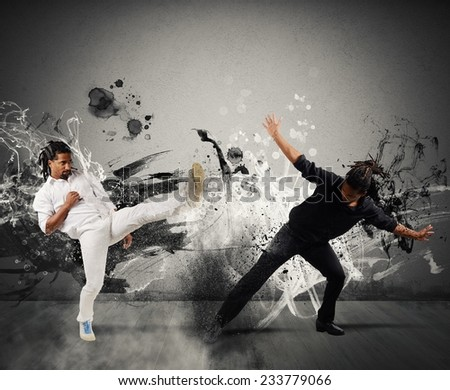 Black and white fighting in the capoeira dance - stock photo