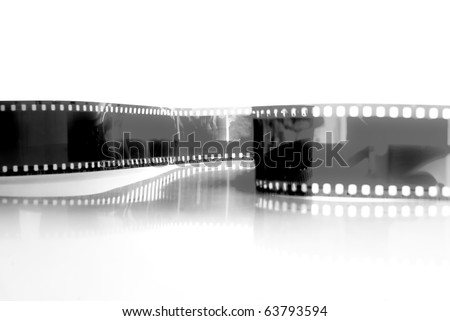 black and white Film strip in front of a white background . - stock photo