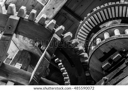 Black and white gears working in an old windmill in Belgium.